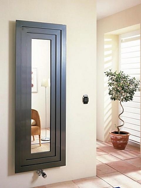 Биметаллический радиатор с нижним подключением, выполненный в виде рамы для зеркала.
