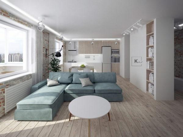 Спальня совмещена с гостиной, при этом зонирование выполняется за счет мебели
