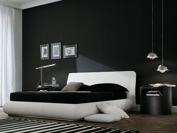 При оформлении черно-белой спальни рекомендуется использовать минимум декора