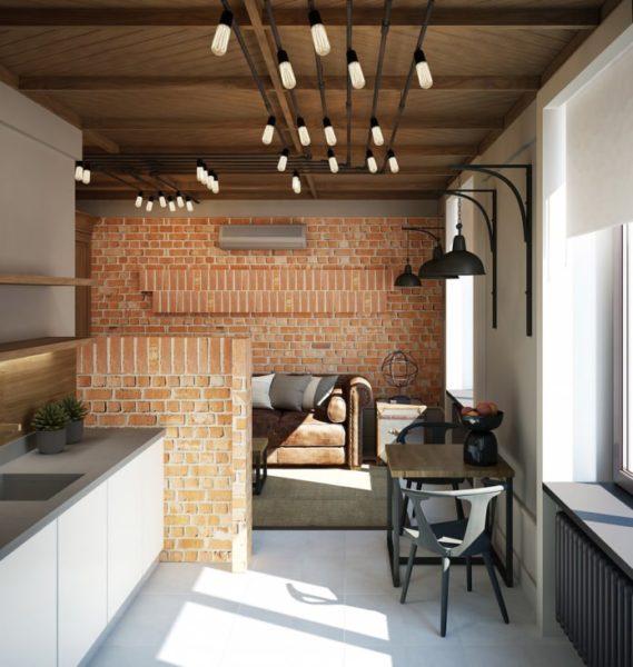 Интерьер оформлен в стиле лофт, кухня и гостиная совмещены