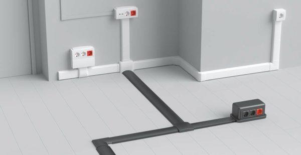 Пример монтажа напольного кабель-канала. Полукруглая форма создает минимальный барьер