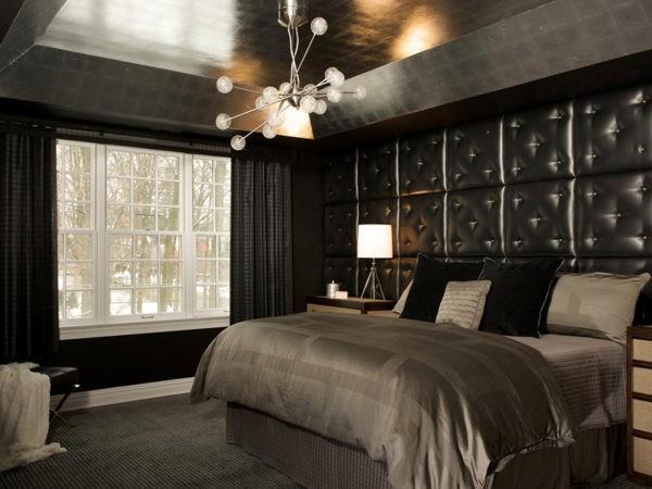 При правильном оформлении интерьера темная спальня может стать очень уютной
