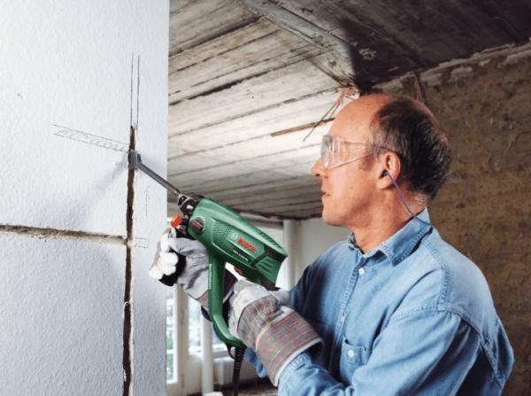 Необходимо углубить проводку в стену и замаскировать штукатуркой